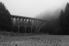 Old Bridge In The Fog On The C...