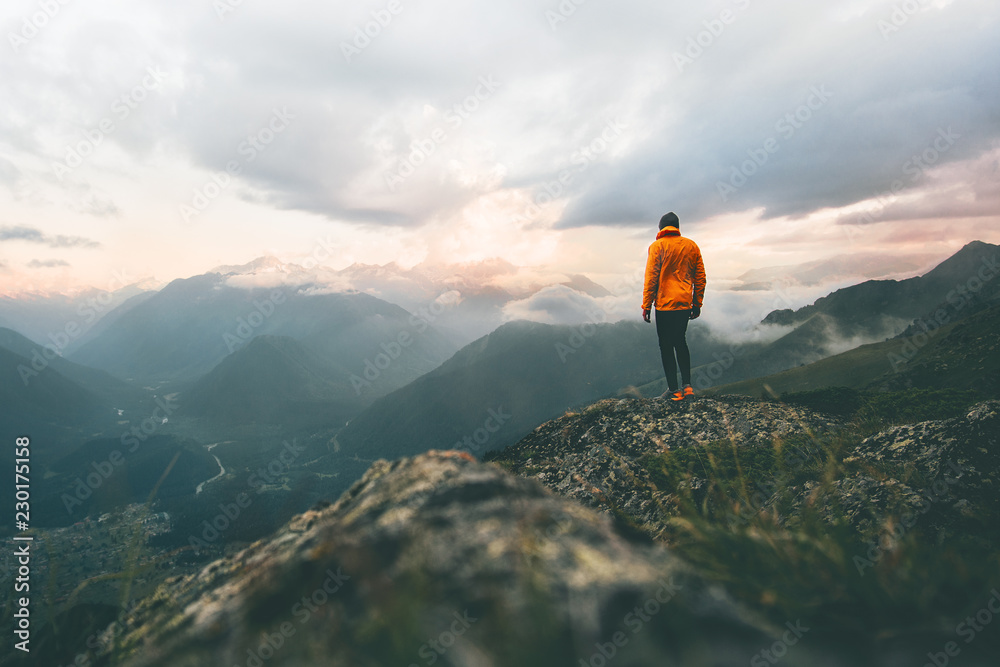 Fototapety, obrazy: Man adventurer on mountain summit hiking Traveling alone heathy lifestyle active vacations trail running outdoor