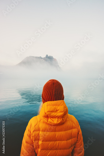 Obraz na plátně Traveler alone looking at foggy sea traveling adventure lifestyle outdoor solitu