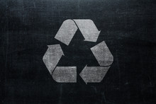 Recycle Sign On Chalkboard Isolated On Blackboard Texture With Chalk Rubbed Background From Top View. Recycling Infographic Element