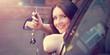 canvas print picture - Frau hält Autoschlüssel aus dem Fenster