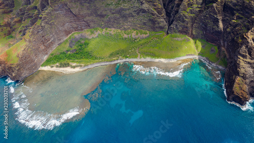Photo Stands Bali Kaahole Valley at the monumental Na Pali Coast, aerial shot from a helicopter, Kauai, Hawaii.