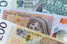 Close-up Macro Photography Of British Pound And Polish Zloty. Business Money Exchange Concept Background.