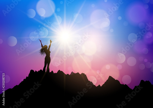 Female on a mountain landscape with arms raised in joy