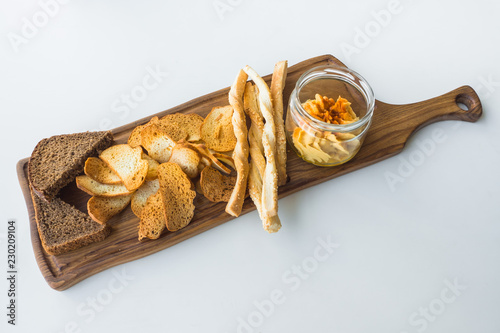 Traditional Israeli hummus with bread chips on the board.