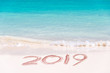 2019 written on the sand of a beach, travel 2019 new year concept