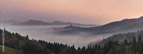 Poster de jardin Colline Panoramic foggy landscape at dawn over mountain and valley