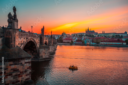 Photo Stands Prague Prague castle and Charles bridge at sunset, Czech republic