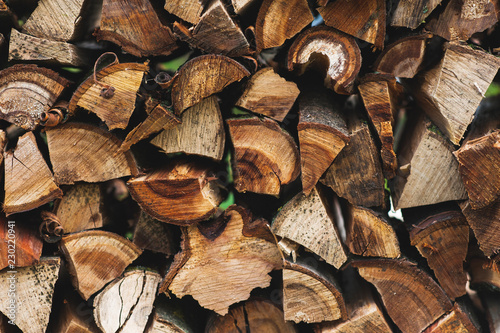 Wall of chopped firewood, texture background