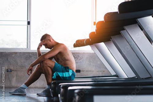 Obraz na plátně  Upset man in the fitness after bad running results