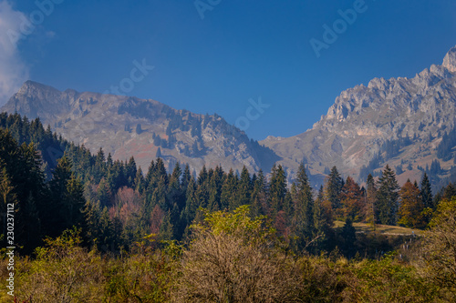 Deurstickers Alpen Top of a mountain in the European Alps in Austria in autumn colors, nature background concept
