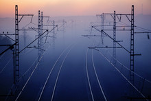 Railways & Electricity Pylons At Sunset, Industrial Landscape