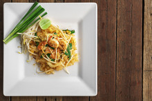 Top View Overhead Photo, Traditional Thai Food, Shrimp Pad Thai Noodle On White Dish
