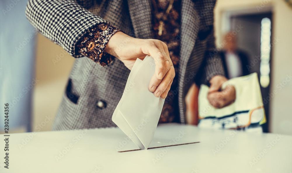 Fotografie, Obraz  Person voting, casting a ballot