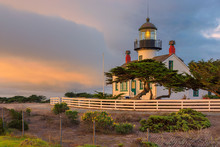 California Lighthouse With Dramatic Sky. Point Pinos Lighthouse  At Sunset In Pacific Grove, Monterey, California.
