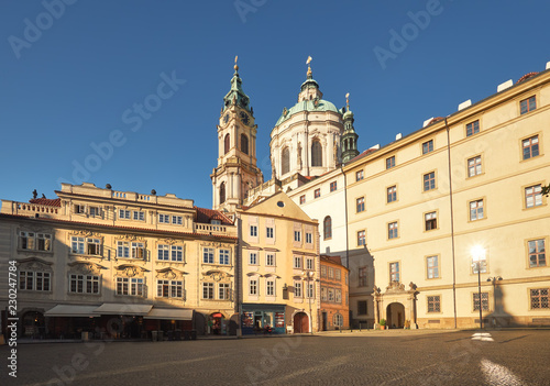 St. Nicolas church and and old buildings in central Prague Wallpaper Mural