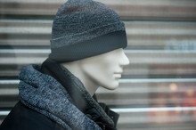 Closeup Of Wool Hat And Blue Winter Coat On Mannequin In Fashion Store Showroom For Men