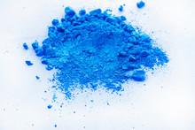 Blue Color Background Of Chalk Powder. Blue Color Dust Particles Splattered On White Background.