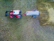 Aerial View Of Tractor Sprayin...