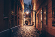 canvas print picture - Old town street at night in Budapest, Hungary