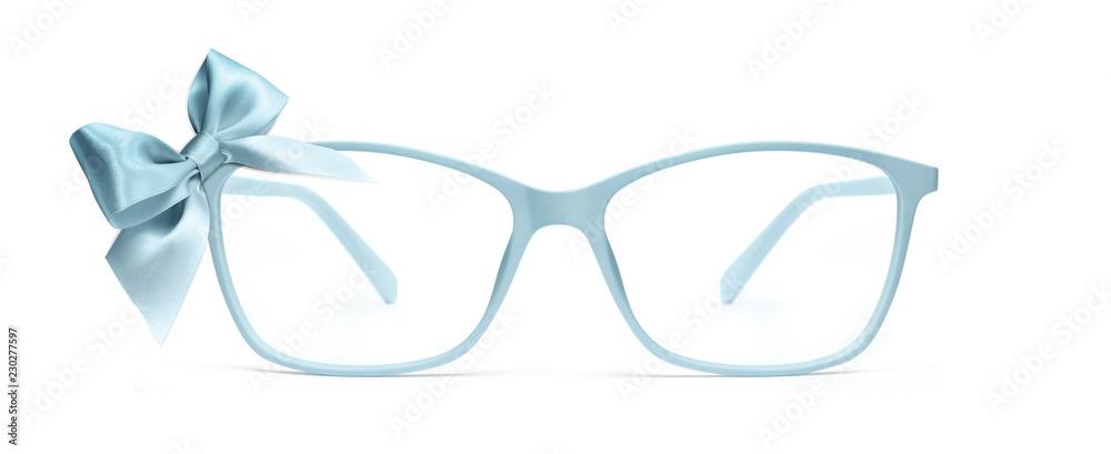 Fototapeta christmas eyeglasses gift card, blue spectacles and blue ribbon bow, isolated on white background