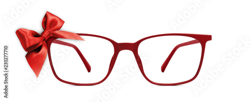 Obraz na płótnie christmas eyeglasses gift card, red spectacles and red ribbon bow, isolated on w
