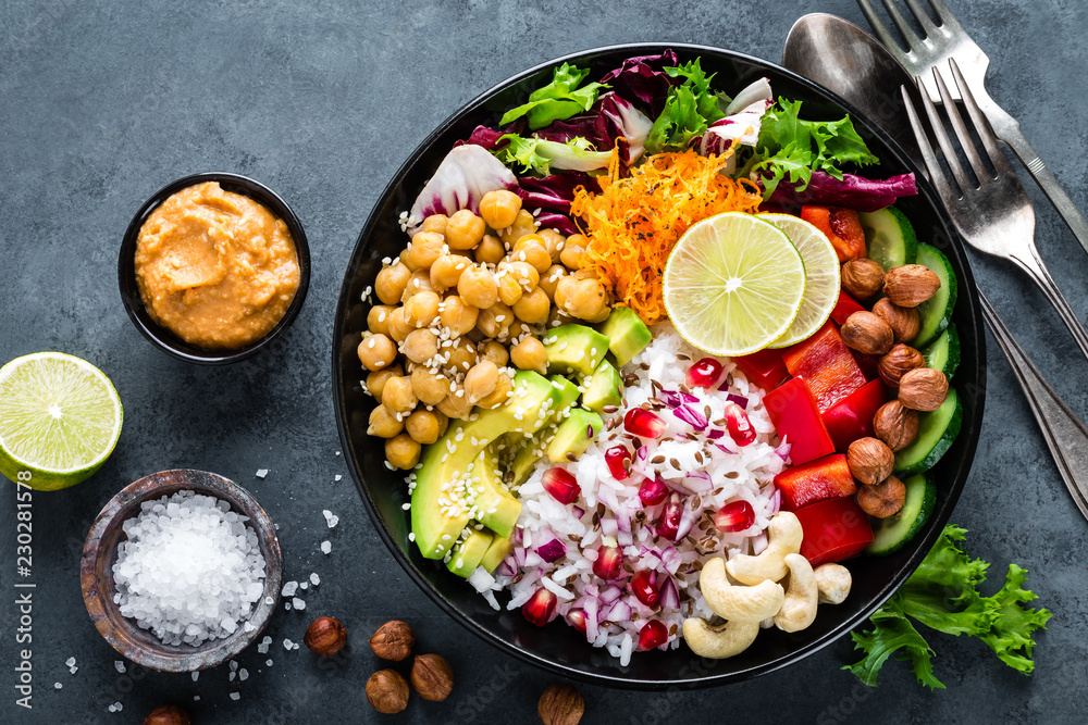 Fototapety, obrazy: Healthy vegetarian Buddha bowl with fresh vegetable salad, rice, chickpea, avocado, sweet pepper, cucumber, carrot, pomegranate and nuts closeup