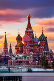 Moscow, Capital city of Russia. Beautiful view of Saint Basil`s Cathedral during sunset time. Clouds are in purple and orange colors.