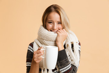 Fototapeta Portrait of a smiling girl dressed in sweater and scarf