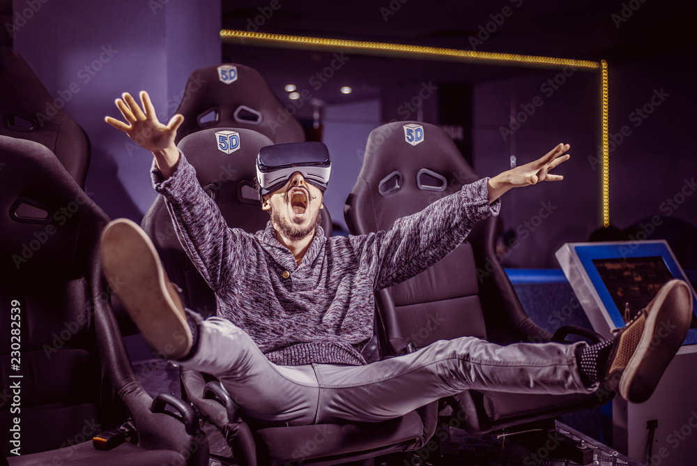 Fototapety, obrazy: man in virtual glasses is watching a movie in 5d in a cinema