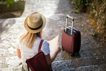 Girl Traveler With Suitcase Is...