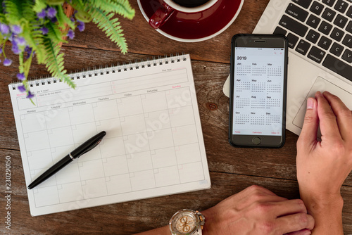 Fotografía SEPTEMBER 17, 2018: Working table top with organizer for monthly planing with a