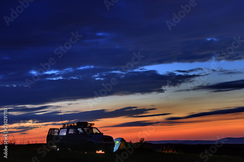Fotobehang Pier Car travelers at sunset in the mountains in the North Caucasus in Russia.