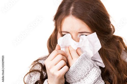 Fotografija Sick freezing woman sneezing in tissue
