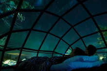 CLOSE UP Young Caucasian Tourist Couple Observing The Night Sky From Glass House