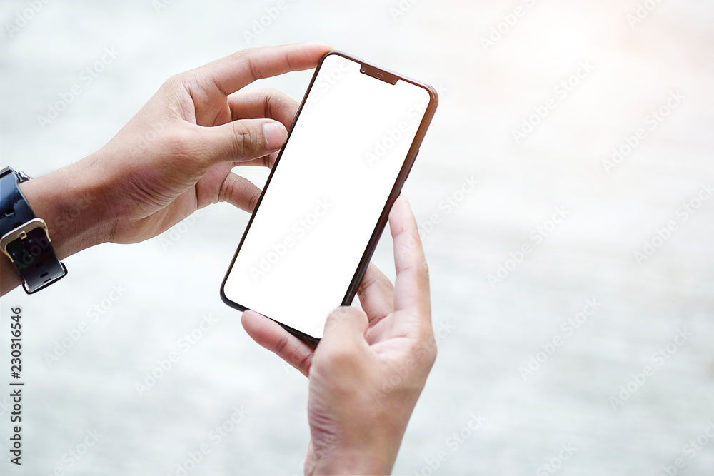 Fototapeta Mock up smartphone of hand holding black mobile phone with blank white screen