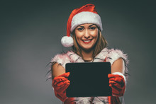 Girl With Santa Hat And Tablet