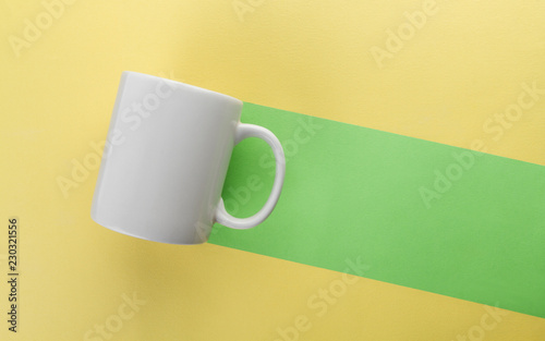 Mug green trail on yellow background - Negative space background concept