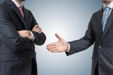 Handshake Refuse. Man Is Refusing Shake Hand With Businessman Who Is Offering Hand.