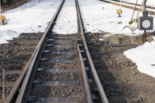 Railway tracks and switch in winter with snow
