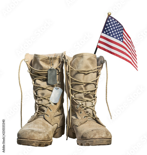 Fotografering Old military combat boots with the American flag and dog tags, isolated on white background