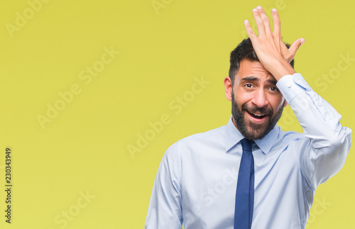 Obraz Adult hispanic business man over isolated background surprised with hand on head for mistake, remember error. Forgot, bad memory concept. - fototapety do salonu