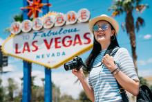Female Photographer Joyfully Carrying Camera