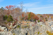Rocky Riverbank Of Potomac River In Autumn. Great Falls State Park Trails Run Across Rocky Terrain Along The Water.