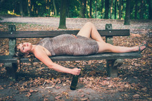 Pregnant Woman Drinking Wine In The Park - Alcoholism Concept