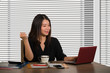 young beautiful and successful Asian Korean business woman working confident at modern office computer desk in female businesswoman success