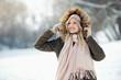 Leinwandbild Motiv Beautiful young woman enjoying in the snow