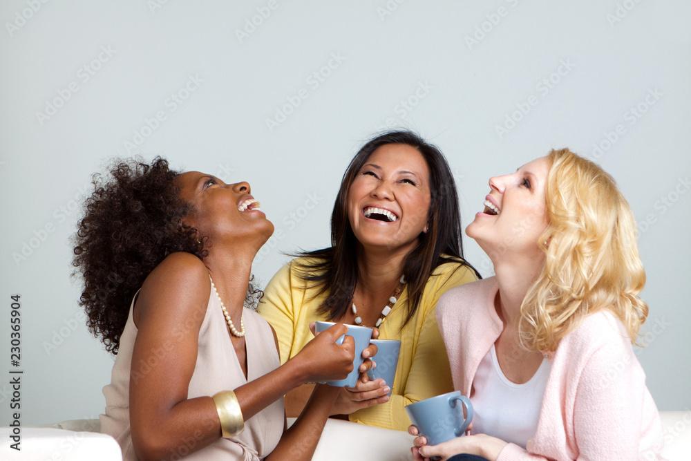 Fototapeta Diverse group of women talking and drinking coffee.