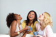 canvas print picture - Diverse group of women talking and drinking coffee.