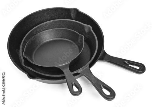 Cast iron pans with empty space, isolated on white background. Cut out objects with top view or high angle view and copy space.